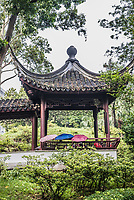 people at gazebo in Kowloon Walled City Park in Hong Kong