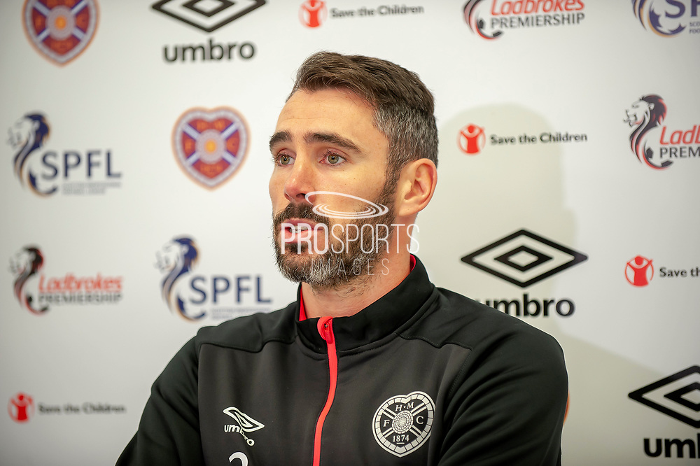 Michael Smith of Heart of Midlothian speaking to the media during the Heart of Midlothian pre match press conference ahead of the visit of Livingston, at Oriam Sports Performance Centre, Riccarton, Edinburgh, Scotland on 20 September 2018.