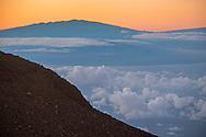 View of Mauna Kea on the Big Island of Hawai'i seen from the summit of Haleakala, Haleakala National Park, Maui, Hawaii