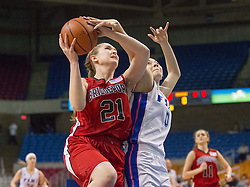 Bridgeport center Katherine Stalnaker (21) is fouled by Fairmont Senior guard Erica Bowles (0) during a first round game at the Charleston Civic Center.