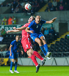 SWANSEA, ENGLAND - Friday, September 4, 2009: Wales' Sam Vokes and Italy's Giuseppe Bellusci during the UEFA Under 21 Championship Qualifying Group 3 match at the Liberty Stadium. (Photo by David Rawcliffe/Propaganda)