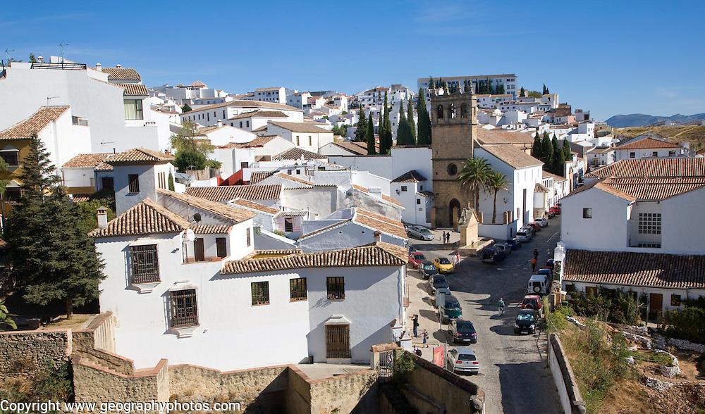 Church Iglesia de Nuestro Padrre Jesus and white buildings in the new city of Ronda, Spain