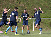 Worthing United players warming up in tribute shirts during the FA Vase 1st Qualifying Round match between Worthing United and East Preston FC at the Robert Eaton Memorial Ground, Worthing, United Kingdom on 6 September 2015. The first home match for Worthing United since losing team mates Matthew Grimstone and Jacob Schilt in the Shoreham air show disaster.