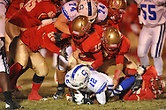 Lafayette High's Chequille Williams (22), Lafayette High's Kalen Coleman (16), Lafayette High's Alec Michael (7), and Lafayette High's Eric Lewis (35) make a tackle vs. Senatobia in Oxford, Miss. on Friday, October 19, 2012. Lafayette High won 23-7.