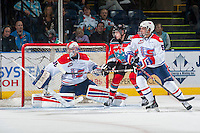 KELOWNA, CANADA - NOVEMBER 7: Tomas Soustal #15 of Kelowna Rockets stands between Garret Hughson #30 and Jeff Rayman #5 of Spokane Chiefs on November 7, 2014 at Prospera Place in Kelowna, British Columbia, Canada.  (Photo by Marissa Baecker/Shoot the Breeze)  *** Local Caption *** Tomas Soustal; Garret Hughson; Jeff Rayman;