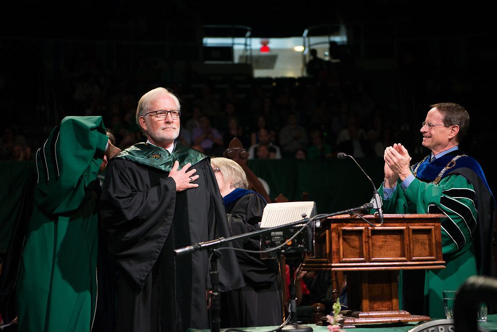 OHIO alum David Crane receives an honrary doctorate degree from Interim President David Descutner. Photo by Ben Siegel