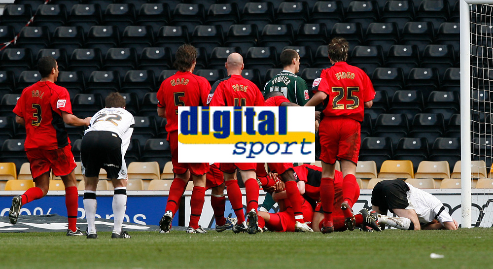 Photo: Steve Bond.<br />Derby County v Coventry City. Coca Cola Championship. 09/04/2007. Leon McKenzie (buried) celebrates his goal despite getting injured