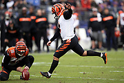 Cincinnati Bengals punter Kevin Huber (10) holds while Cincinnati Bengals kicker Randy Bullock (4) misses a potentially game tying 52 yard field goal that leaves the score at 24-21 late in the fourth quarter during the NFL week 11 regular season football game against the Baltimore Ravens on Sunday, Nov. 18, 2018 in Baltimore. The Ravens won the game 24-21. (©Paul Anthony Spinelli)