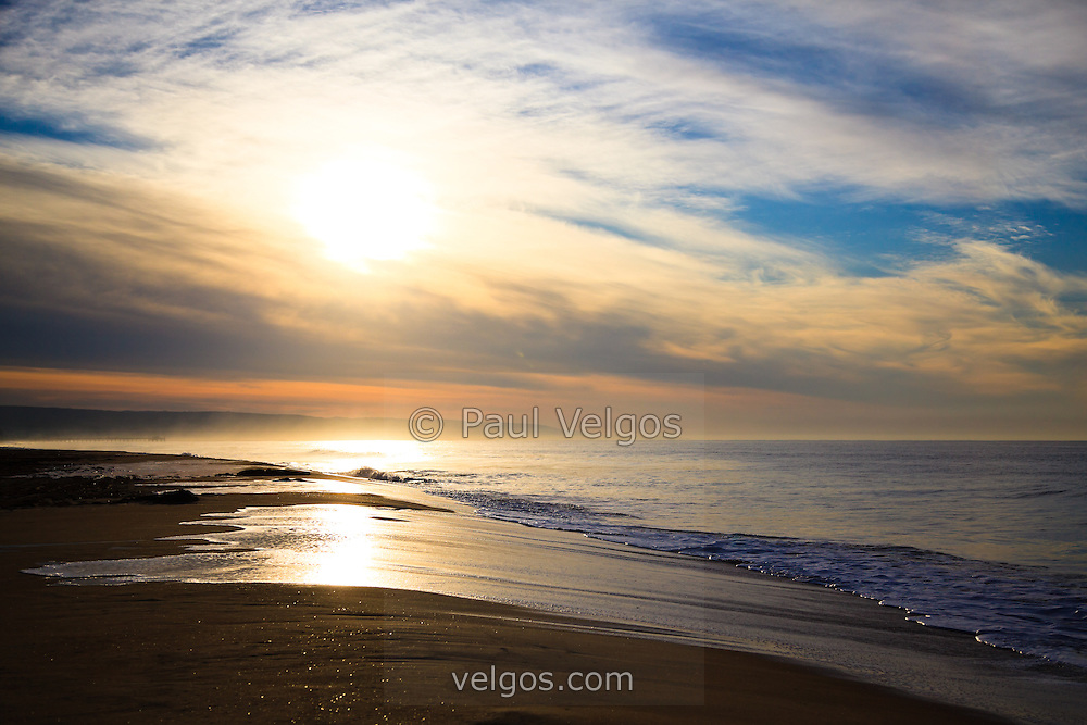 Picture of Newport Beach sunrise along the Pacific Ocean. Taken from Balboa Peninsula Beach in Orange County Southern California. High resolution photo.