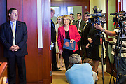 09 MAY 2011 - PHOENIX, AZ: JAN BREWER, the Republican Governor of Arizona, walks into a press conference at the Arizona State Capitol in Phoenix Monday. Governor Jan Brewer, State Senate President Russell Pearce and Attorney General Tom Horne, all Republicans, held one press conference to announce that the state was suing to take its legal battle over SB1070, Arizona's tough anti-immigration law, past the US Court of Appeals and straight to the US Supreme Court. State Senator Steve Gallardo, a Democrat, held a press conference to announce that he was opposed to the Republican's legal actions and called on them to drop the suit altogether. Isolated shouting matches broke out between activists on both sides of the immigration issue during the press conferences.       Photo by Jack Kurtz