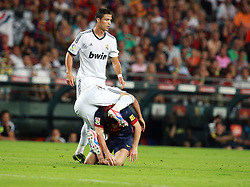 Coentrao tackles Lionel Messi during the Supercopa 1st leg match at the Nou Camp, Barcelona, Spain between FC Barcelona and Real Madrid on 23rd August 2012.