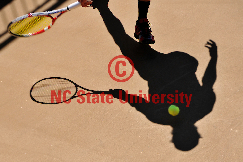 Freshman Robbie Mudge returns a shot against Maryland on Court 5.