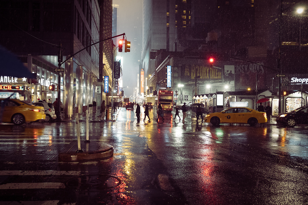 Streets of NYC in the rain at night.