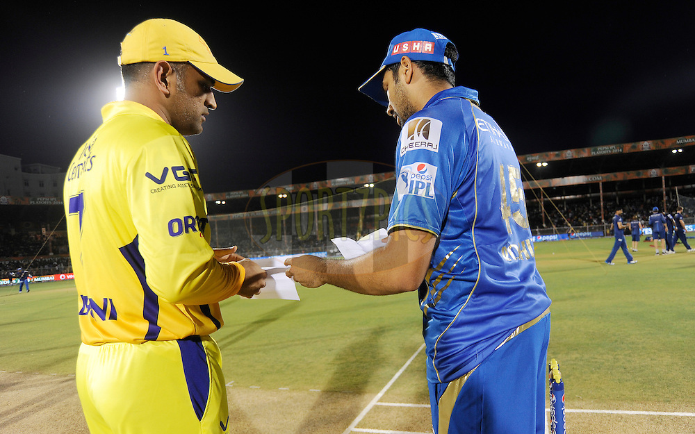 MS Dhoni captain of The Chennai Superkings and Rohit Sharma captain of the Mumbai Indians during the toss before the start of the eliminator match of the Pepsi Indian Premier League Season 2014 between the Chennai Superkings and the Mumbai Indians held at the Brabourne Stadium, Mumbai, India on the 28th May  2014<br /> <br /> Photo by Pal PIllai / IPL / SPORTZPICS<br /> <br /> <br /> <br /> Image use subject to terms and conditions which can be found here:  http://sportzpics.photoshelter.com/gallery/Pepsi-IPL-Image-terms-and-conditions/G00004VW1IVJ.gB0/C0000TScjhBM6ikg