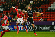 Charlton Athletic forward Lyle Taylor (9) and Portsmouth defender Christian Burgess (6) in the air challenge for the ball during the EFL Sky Bet League 1 match between Charlton Athletic and Portsmouth at The Valley, London, England on 9 March 2019.