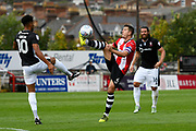 Lloyd James (4) of Exeter City hooks the ball away from Matthew Green (10) of Lincoln City during the EFL Sky Bet League 2 match between Exeter City and Lincoln City at St James' Park, Exeter, England on 19 August 2017. Photo by Graham Hunt.