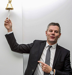 "Derek Mackay, Finance Secretary (left), rings the ""Success Bell"" at the official opening of the building services firm's office at Ratho, Edinburgh. The bell is rung to mark achievements by the company and its employees. Pic: Terry Murden @edinburghelitemedia"