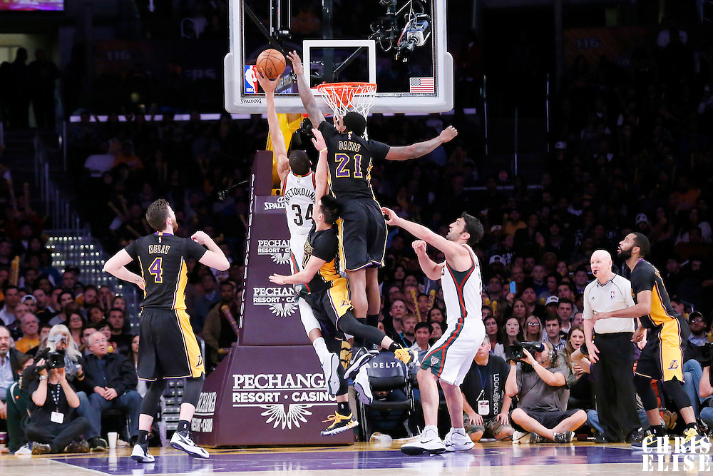 27 February 2015: Milwaukee Bucks forward Giannis Antetokounmpo (34) is blocked by Los Angeles Lakers forward Ed Davis (21) during the Los Angeles Lakers 101-93 victory over the Milwaukee Bucks, at the Staples Center, Los Angeles, California, USA.