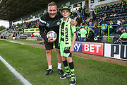 Forest Green Rovers assistant manager, Scott Lindsey with the mascot during the EFL Sky Bet League 2 match between Forest Green Rovers and Exeter City at the New Lawn, Forest Green, United Kingdom on 9 September 2017. Photo by Shane Healey.