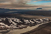 Lava flow from Holuhraun eruption, Herdubreid the national mountain if Iceland in background.
