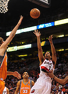 Mar. 21 2010; Phoenix, AZ, USA; Portland Trailblazers guard Andre Miller (24) puts up a shot against Phoenix Suns center Robin Lopez (15) in the first half at the US Airways Center. The Suns defeated the Trail Blazers 93 to 87. Mandatory Credit: Jennifer Stewart-US PRESSWIRE.