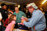 Lucky the Clown puts eyes on a poodle for a visitor during the 10th Annual Celebrating life & health free community health fair at Sinclair's Ponitz Center in downtown Dayton, Saturday, April 21, 2012. More than 50 vendors were spread over three floors providing vision, hearing, blood pressure and other screenings, health information and entertainment.