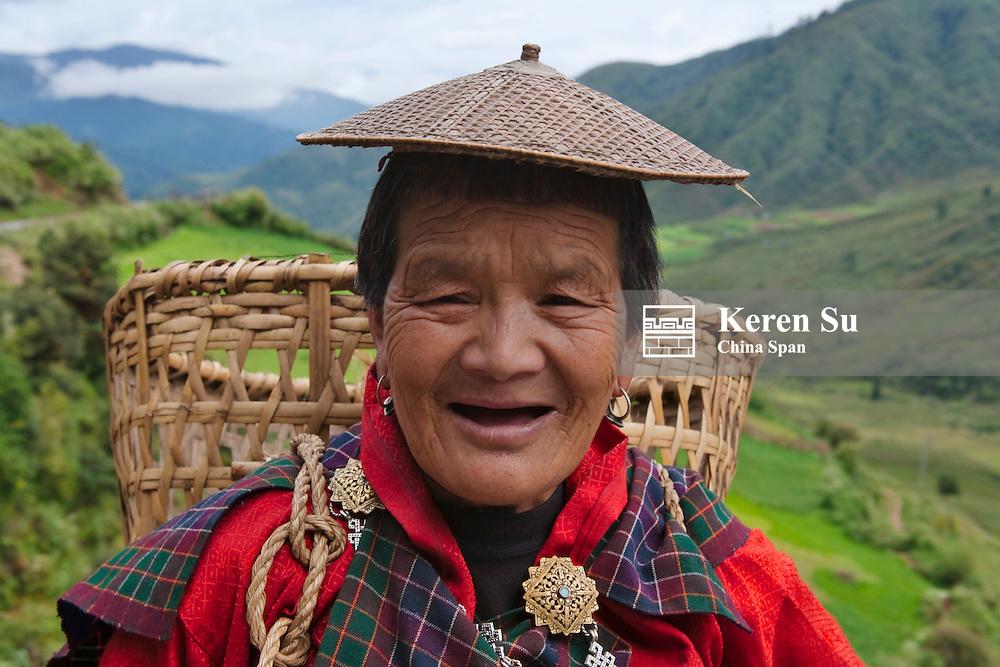 Portrait of a farmer carrying basket, Mangdue Valley, Bhutan