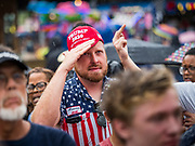 11 AUGUST 2019 - DES MOINES, IOWA: A man flips off a Donald Trump supporter while Bill Weld was speaking at the Des Moines Register Political Soap Box. Weld, a two term former governor of Massachusetts, is running to be the Republican nominee for President in 2020. He campaigned at the Iowa State Fair Sunday. He is launching a primary bid against incumbent Donald Trump in New England states and some western states where Trump is not popular.        PHOTO BY JACK KURTZ