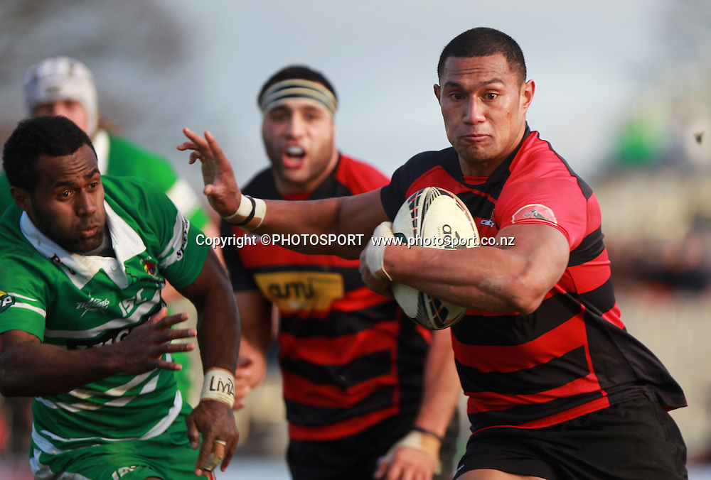 Canterbury player Robbie Fruean fends off Tamasi Cama. ITM Cup rugby union game, Canterbury v Manawatu. Rugby Park, Christchurch, Saturday 30 July 2011. Photo : Joseph Johnson/photosport.co.nz