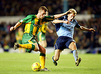 Photograph: Scott Heavey.<br />Coventry v West Bromwich Albion. Nationwide Division One. 20/12/2003.<br />Geoff Horsefield attempts to shoot past Calum Davenport