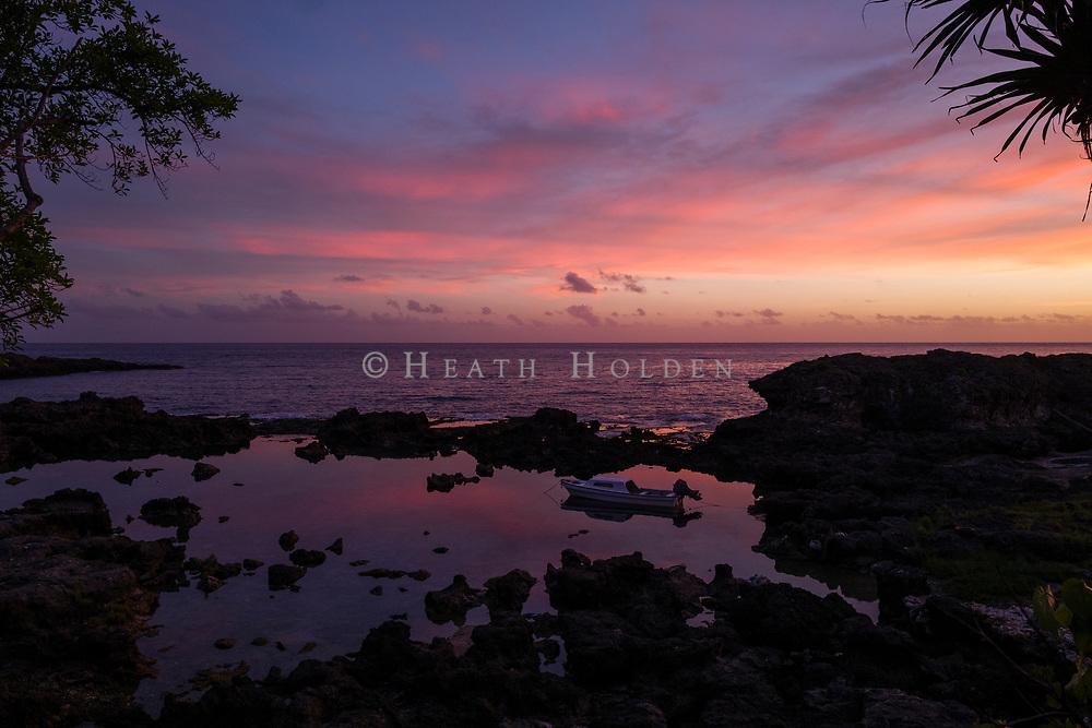 Vibrant sunset off the coast of Lenakel, on Vanuatu's Tanna Island.