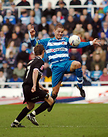 Photo: Kevin Poolman.<br />Reading v Derby County. Coca Cola Championship. 01/04/2006. Reading's Ivar Ingimarsson gets to the ball before Tommy Smith (L).