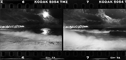 View from Bondi Icebergs at night, full moon, large swell, waves breaking over the side of the swimming pool,consecutive frames on a roll of tmax 3200 high speed film arranged as a dyptich