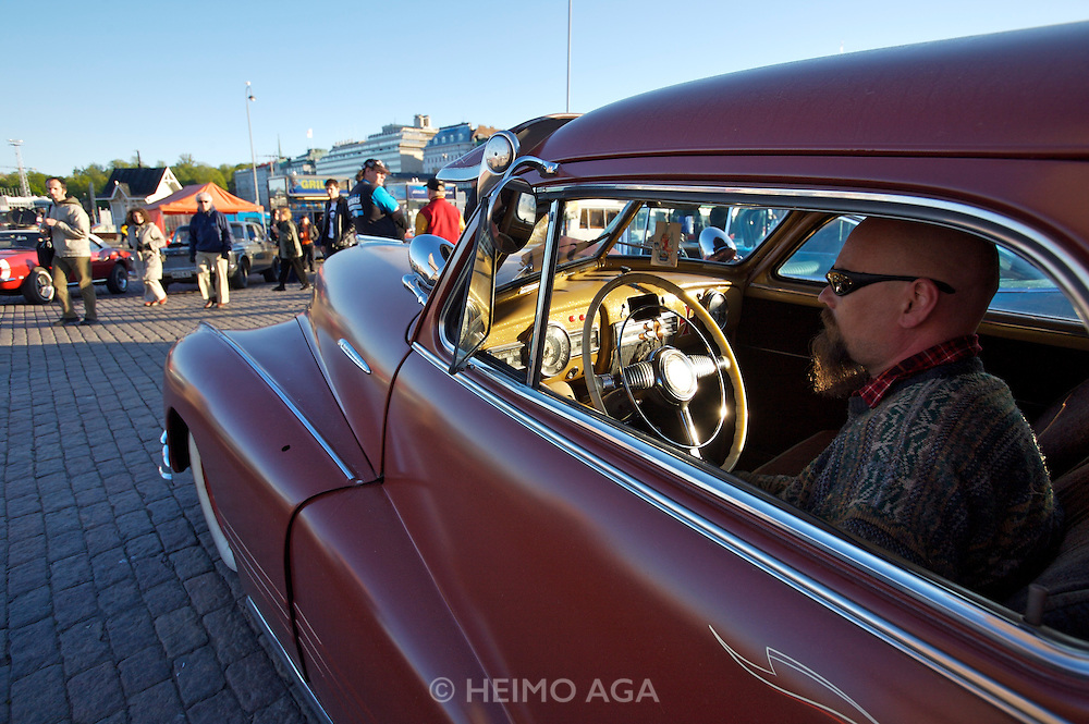 During summer from June to Septemper, every first Friday of the month is Vintage Car Cruising Night. Hundreds of classic American cars cruise around downtown Helsinki and meet at special places to have a good time, here at Kauppatori (Market Square). A low rider Cadillac Sedan from the Fourties.
