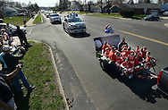 FAIRLESS HILLS, PA - APRIL 12: Baseball players sit on a trailer and wave to the crowd during the Fairless Hills Little League opening day parade on North Oxford Valley Road April 12, 2014 in Fairless Hills Pennsylvania. (Photo by William Thomas Cain/Cain Images)