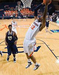 Virginia forward Mike Scott (32) goes up for a dunk.  The Virginia Cavaliers defeated the Shepherd Rams 87-52 in an NCAA basketball exhibition game at the University of Virginia's John Paul Jones Arena in Charlottesville, VA on November 9, 2008.
