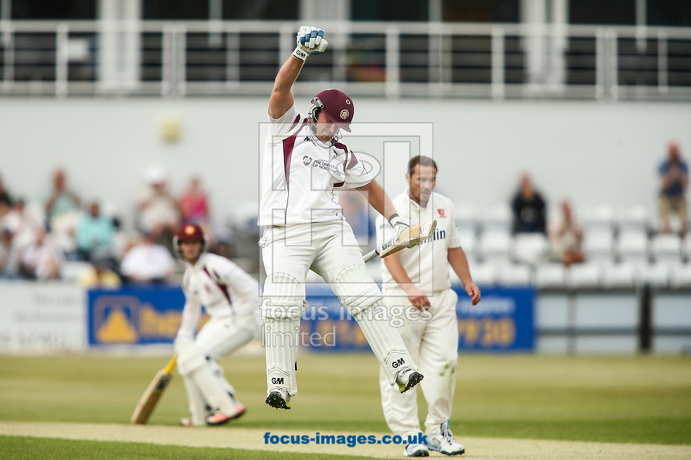 Richard Levi of Northamptonshire (centre) celebrates reaching his century during the LV County Championship Div Two match at the County Ground, Northampton<br /> Picture by Andy Kearns/Focus Images Ltd 0781 864 4264<br /> 08/06/2015