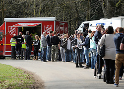 ©London News pictures. 22/03/11. The queue of people waiting to sign up to join the search.  Locals and friends of Sian O'Callaghan help Police in the search in Savernake Wood, Wiltshire, today. Detectives continue investigating the disappearance of office administrator Sian O'Callaghan. The 22-year-old disappeared after leaving Suju nightclub in Swindon at about 2.50am on Saturday to walk the half-mile home to the flat she shared with her boyfriend Kevin Reape. Picture Credit should read Stephen Simpson/LNP