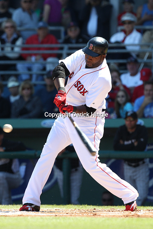 March 12, 2011; Fort Myers, FL, USA; Boston Red Sox first baseman David Ortiz (34) connects with the ball for a double during a spring training exhibition game against the Florida Marlins at City of Palms Park. The Red Sox defeated the Marlins 9-2.  Mandatory Credit: Derick E. Hingle