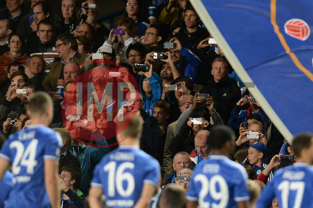 LONDON, ENGLAND - September 18: Fans capture images of the Chelsea team on the phone cameras before the UEFA Champions League Group E match between Chelsea from England and Basel from Switzerland played at Stamford Bridge, on September 18, 2013 in London, England. (Photo by Mitchell Gunn/ESPA)