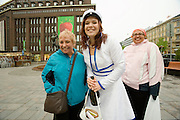 Famous Finnish design textiles by Marimekko. On Graduation Day, school girls (and boys) celebrate the end of 12 hard school years, wearing students' caps and roaming the city's streets having fun.