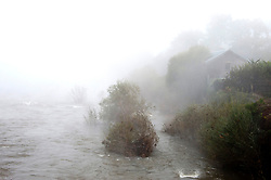 © Licensed to London News Pictures. 28/10/2019. Builth Wells, Powys, Wales, UK. Fog hangs over the river wye after water levels drop back to normal.  After recent days of relentless rain, and severe flooding from the river Wye, cold weather and fog hit Powys with temperatures dropping to below freezing last night in the small market town of Builth Wells. Photo credit: Graham M. Lawrence/LNP