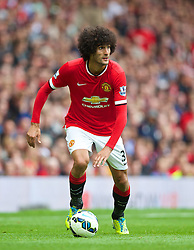 16.08.2014, Old Trafford, Manchester, ENG, Premier League, Manchester United vs Swansea City, 1. Runde, im Bild Manchester United's Marouane Fellaini in action against Swansea City // 15054000 during the English Premier League 1st round match between Manchester United and Swansea City AFC at Old Trafford in Manchester, Great Britain on 2014/08/16. EXPA Pictures &copy; 2014, PhotoCredit: EXPA/ Propagandaphoto/ David Rawcliffe<br /> <br /> *****ATTENTION - OUT of ENG, GBR*****