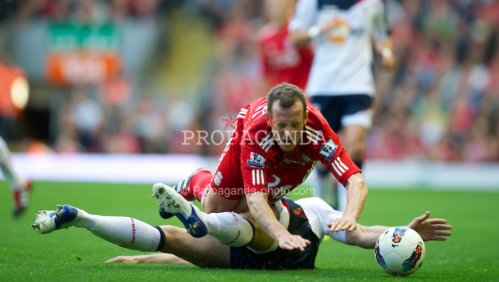 LIVERPOOL, ENGLAND - Saturday, August 27, 2011: Liverpool's Charlie Adam in action against Bolton Wanderers during the Premiership match at Anfield. (Pic by David Rawcliffe/Propaganda)