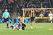 Hull City midfielder Robert Snodgrass (10) and Mohamed Diame (15) Newcastle United midfielder tangle Hull City midfielder Tom Huddlestone (8) in dispair during the EFL Quarter Final Cup match between Hull City and Newcastle United at the KCOM Stadium, Kingston upon Hull, England on 29 November 2016. Photo by Ian Lyall.