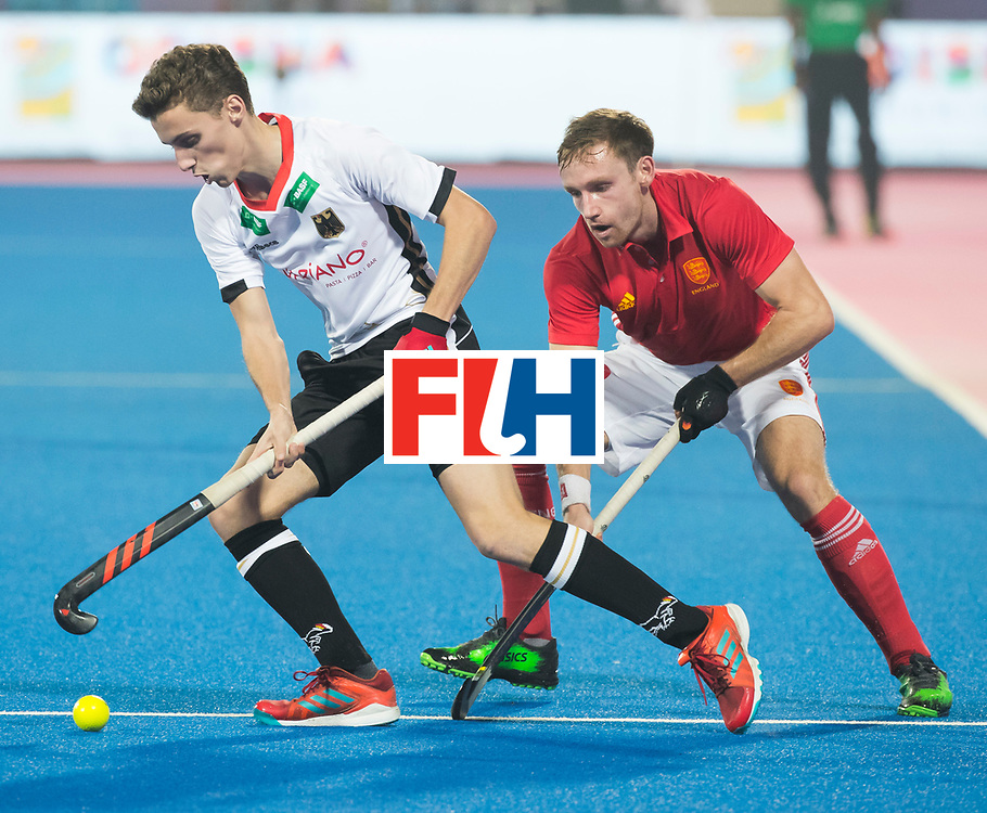 BHUBANESWAR - The Odisha Men's Hockey World League Final . Match ID 01 . Germany v England (2-0). Johannes Grosse (Ger) with David Goodfield (Eng) .WORLDSPORTPICS COPYRIGHT  KOEN SUYK