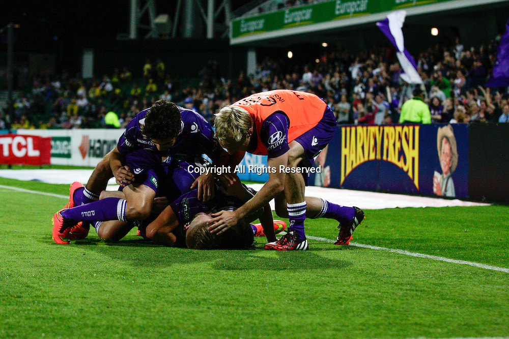 21.11.2014 Perth, Australia. Hyundai A League round 7, Perth Glory versus Wellington Phoenix. Perth Glory players celebrate after a second half goal put them 2 nil up against Wellington Phoenix.