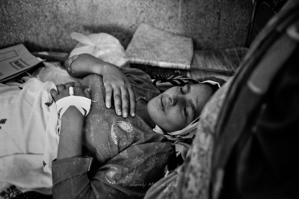 Rabia sleeps while still recovering from a caesarean section she had the day before. Thari Mirwah, Pakistan, 2010