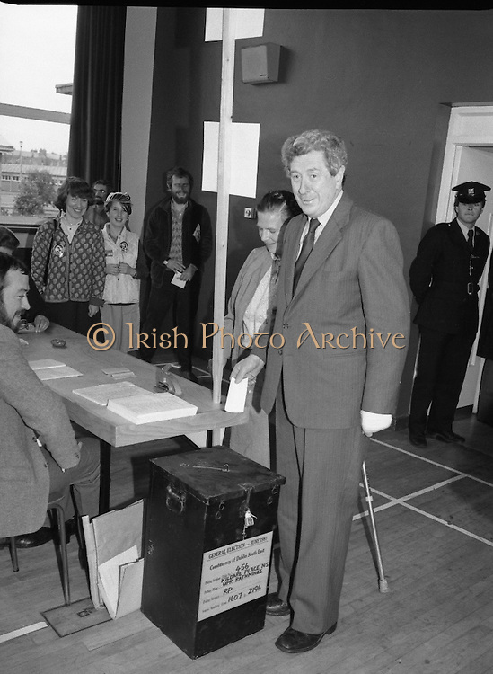 Garret Fitzgerald Votes in General Election. (N81)..1981..11.06.1981..06.11.1981..11th June 1981..After almost a month of campaigning the General Election polling booths opened early this morning. Voting bright and early Dr Garret Fitzgerald and his wife Joan visited their local station in Upper Rathmines,Dublin...Images show Dr and Mrs Fitzgerald casting their votes at Upper Rathmines. Dr Fitzgerald hoped that enough of a swing within the electorate would carry him to power.