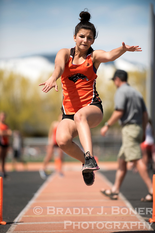 Jackson Hole High School freshman Katie Haldeman takes her third try at the long jump during the school's track meet Saturday afternoon.